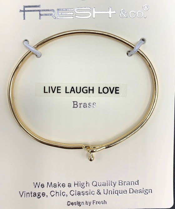 This is a stylish, trendy bangle with Live Laugh Love inscribed on the band. It looks beautiful alone or grouped with other bracelets.