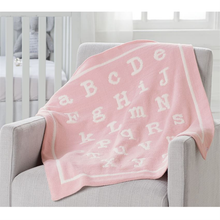 "Load image into Gallery viewer, An incredibly soft double sided chenille knit blanket in pink and cream (Features an ABC pattern)  Dimensions: 34"" x 28"""