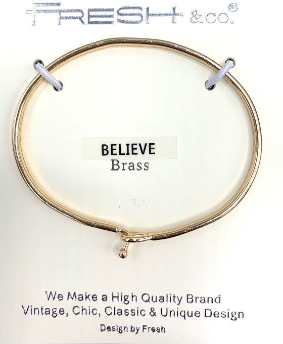 This is a gold stylish bangle inscribed with Believe. It  looks beautiful alone or grouped with other bracelets