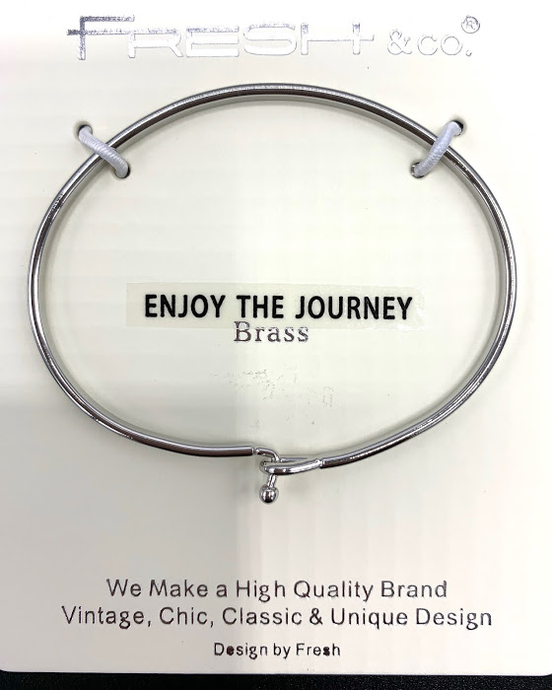 This is a silver stylish bangle inscribed with Enjoy The Journey. It  looks beautiful alone or grouped with other bracelets