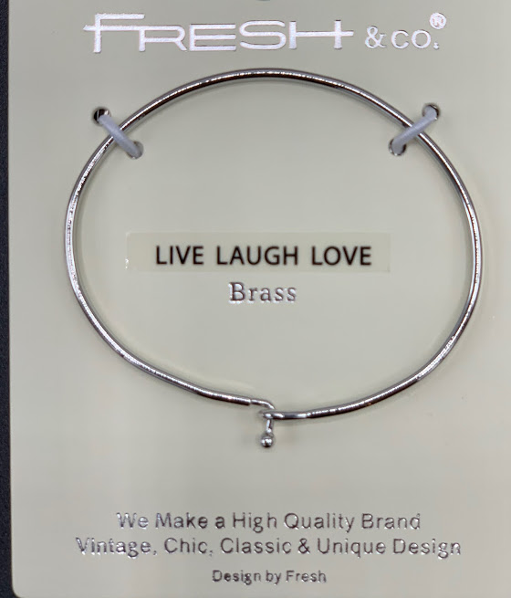 This is a stylish, trendy bangle with Live Laugh Love inscribed on the band. It looks beautiful alone or grouped with other bracelets