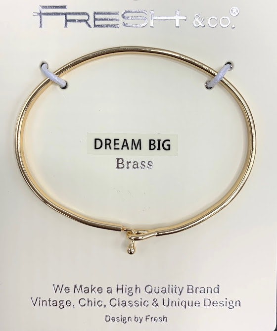 This is a gold stylish bangle inscribed with Dream Big. It  looks beautiful alone or grouped with other bracelets