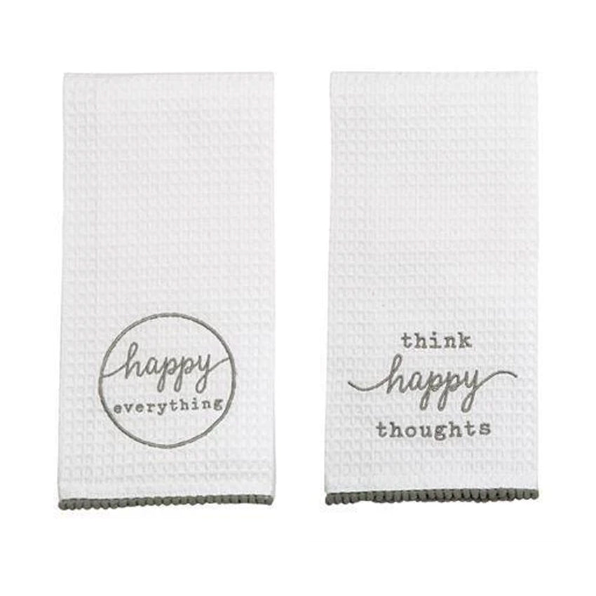 Each waffle weave towel by Mud Pie features an embroidered inspiration that reminds us to be happy, and is trimmed with pom-pom detail. Includes