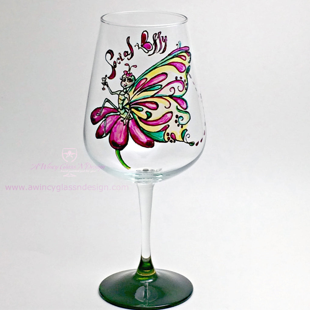 Social butterfly hand painted wine glass a wincy glass n for Hand painted wine glass christmas designs