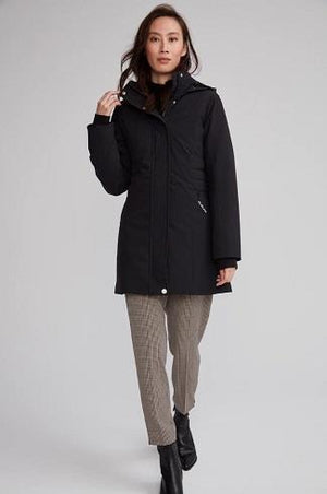 photo of an asian model wearing the Monaco parka in black wearing pants and blk booties