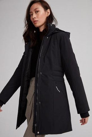 asian woman wearing the monaco parka in black open showing her outfit