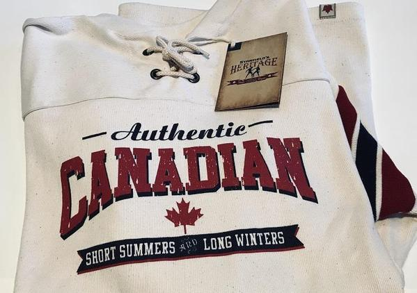 "Stanfield's Heritage Collection Hockey Jersey with ""Canadian"" screensprint folded on a white table."