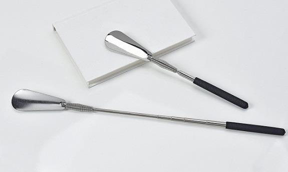 Two telescoping shoe horns, one collapsed and one extended, each with silver heads and black handles.