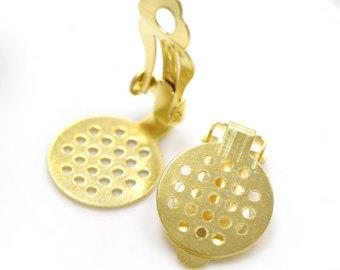 "WOT findings. Earring, disc-clip. 5/8"". Perforated. Gold coloured. 12 pack."