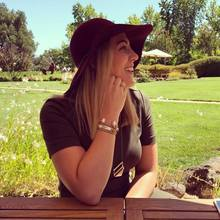 Wine Tasting in napa girl wearing cynthia h designs message bracelet Never Ever Give Up Mini