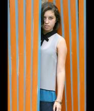 Fashionista girl in orange curtain wearing cynthia h designs message bracelet American Foundation for Suicide Prevention