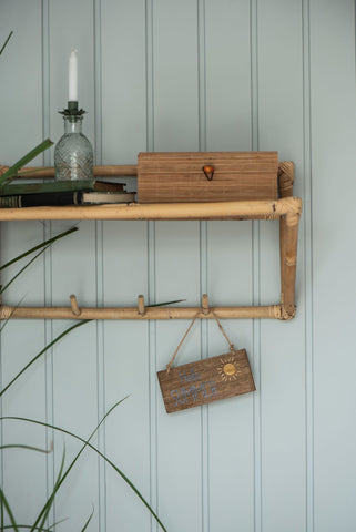 Simple bamboo shelf and peg hanger for hallway