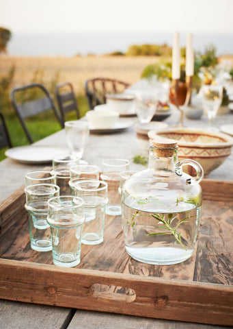 Outdoor table setting with beldi glasses and corked caraffe