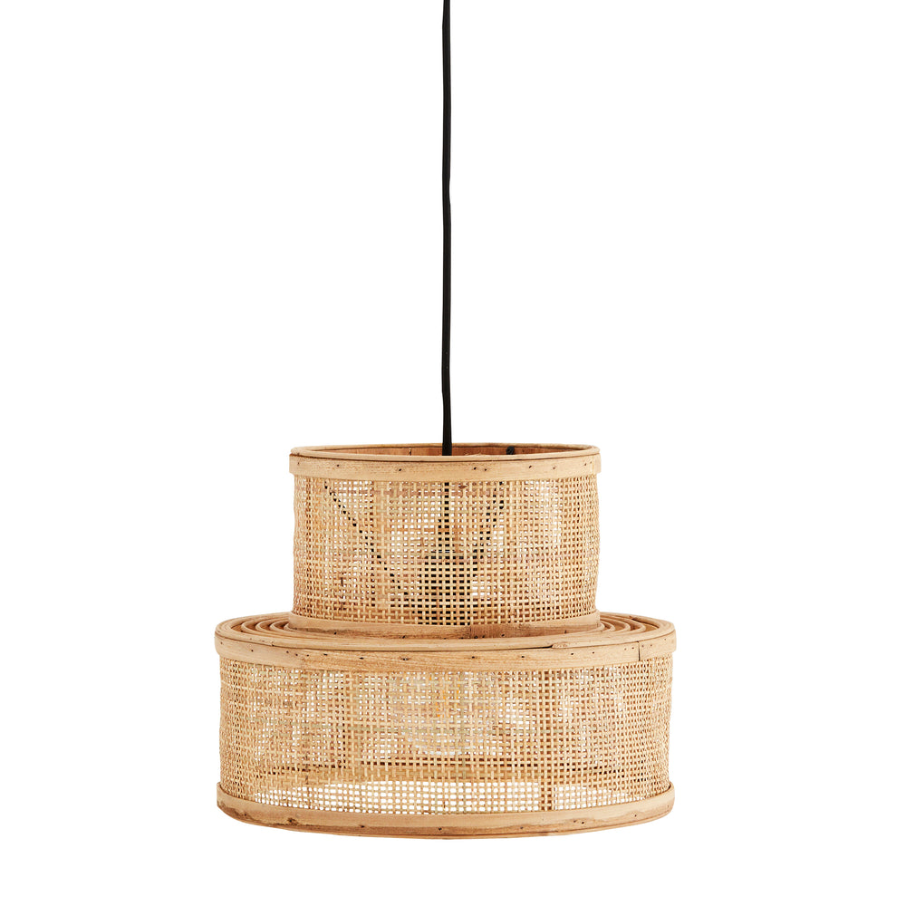 Rattan lampshade with small tier on top of a larger tier at the bottom. hanging from a black cable.