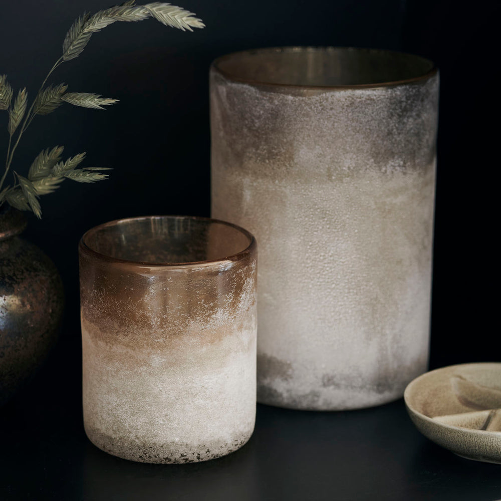 Light brown circular tall glass candle holder with a frosted glass.