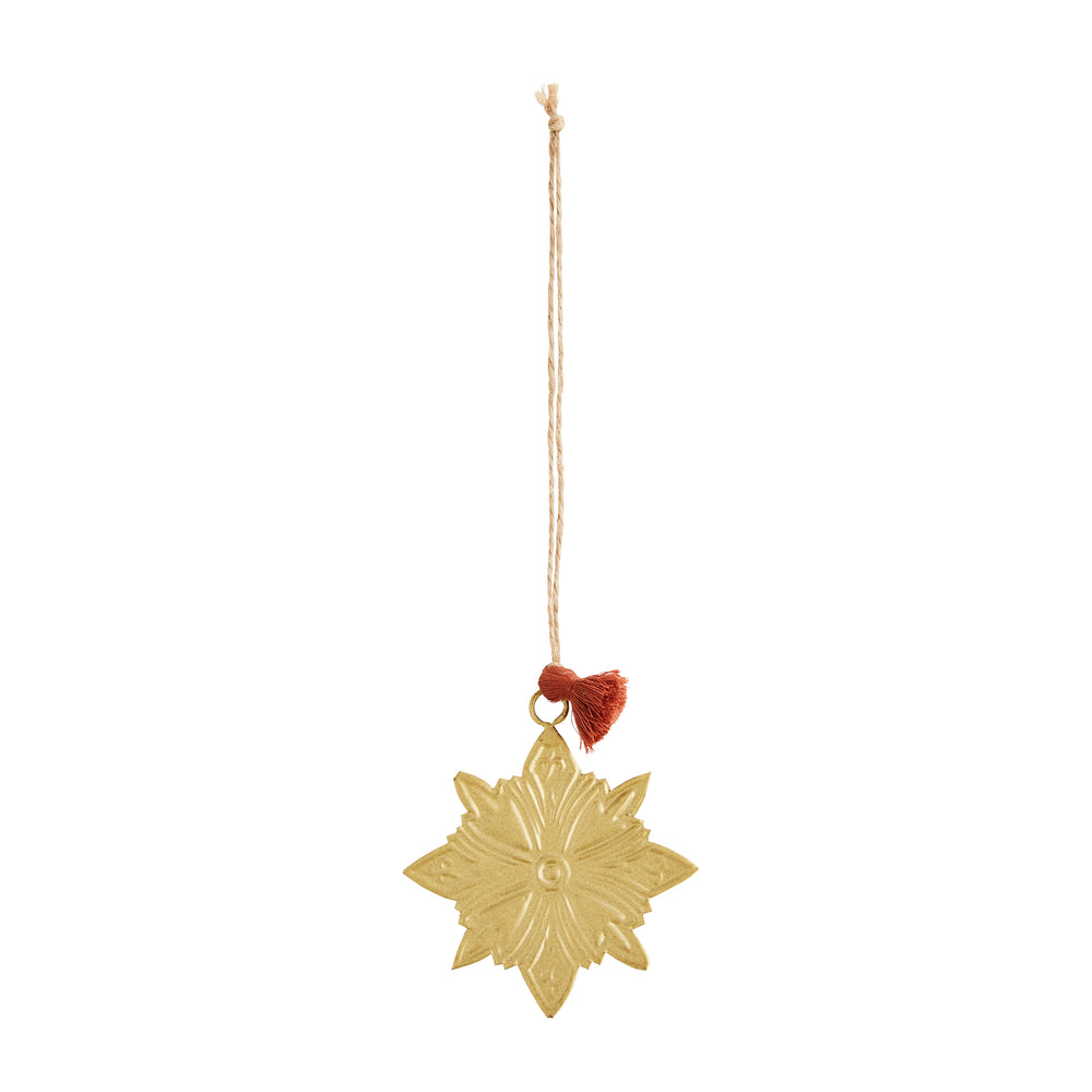 Gold star decoration hanging from a loop of jute twine, with a rust coloured tassel at the bottom.