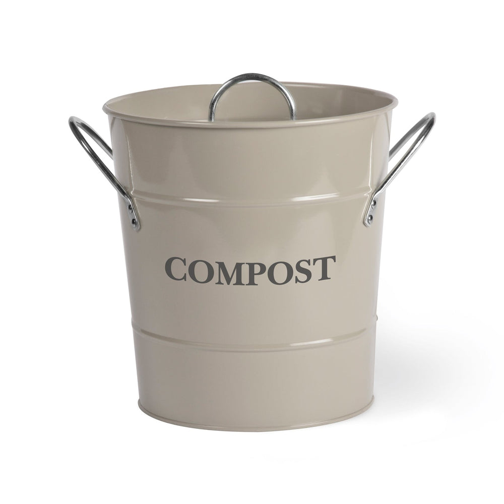 Off-white compost bucket with two silver handles at each side, the word 'COMPOST' printed on the front between two ridges above and below. The lid is airtight and has a silver handle.
