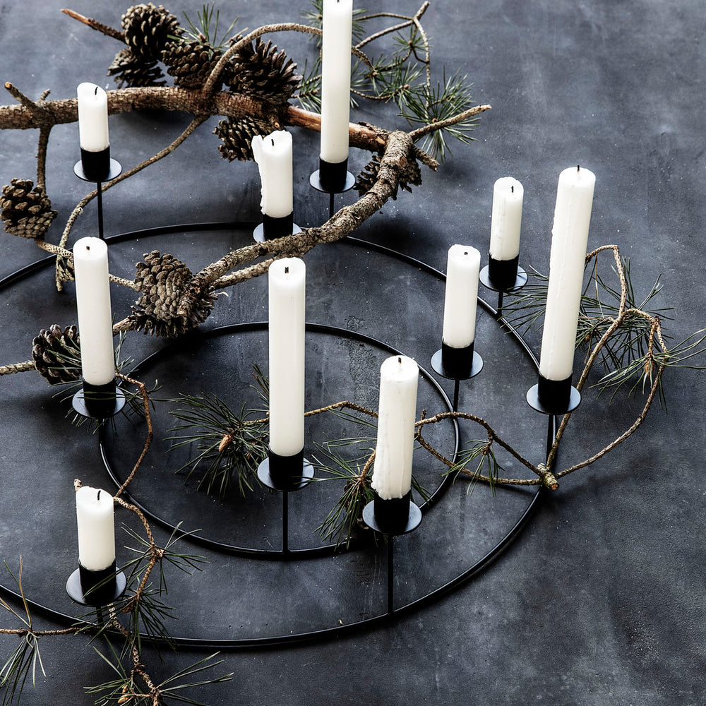 Load image into Gallery viewer, Circular black candle stand made from metal, with eight candle holders at varying heights.