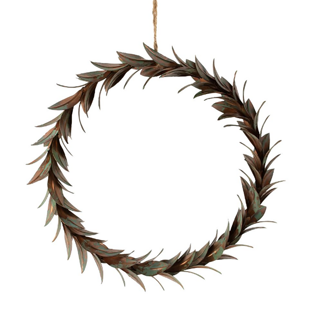 A circle of metal leaves in a copper and green rustic colour hanging from brown string.
