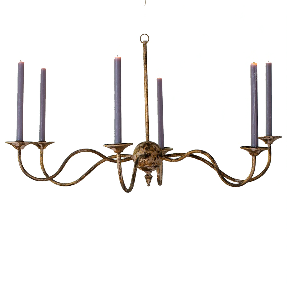 A chandelier made from distressed, rustic metal with gold, off white and brown colouring. Eight candle holders stem off a central globe shape, with a long pole going straight up to a loop that can be attached to a hook on the ceiling.