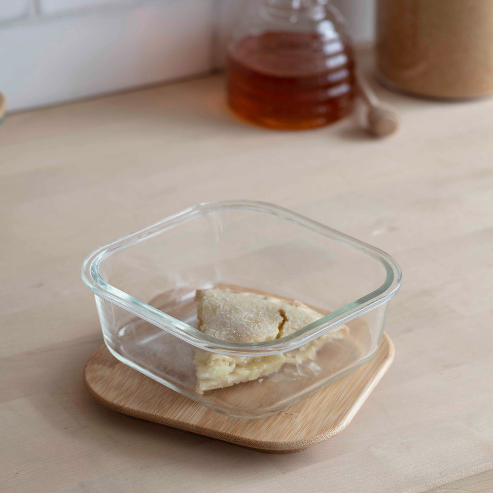 Square clear glass food storage box with light bamboo lid.
