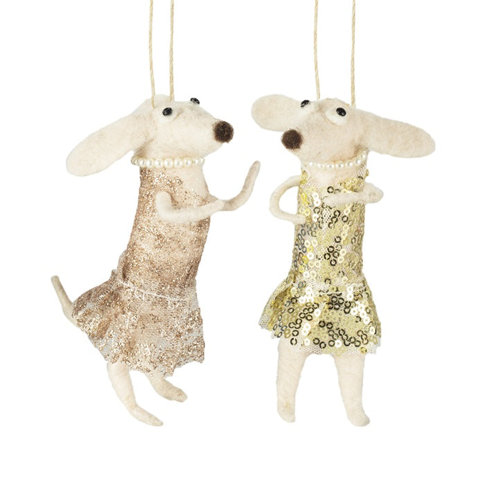 Two white felt dogs with glittery dresses and pearl necklaces