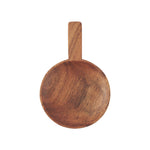 a round wooden dish made from a deep amber acacia wood, with a short handle.