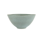 A topaz blue and mottled glazed stoneware serving bowl