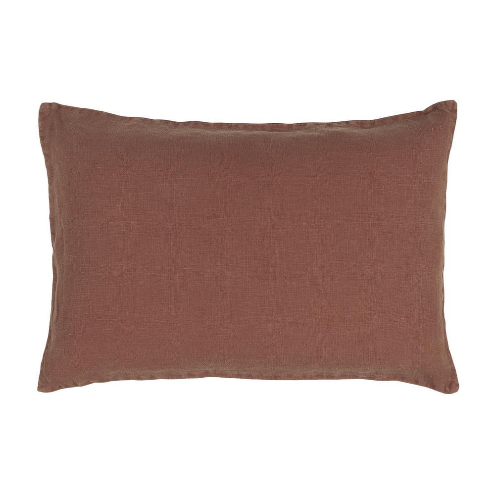 Linen cushion cover in pillow shape, rust orange/brick red colour.