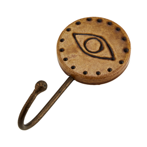Reto unique hook with a round ceramic head featuring an eye design. Caramel colour. Iron Hook. Madam Stoltz.
