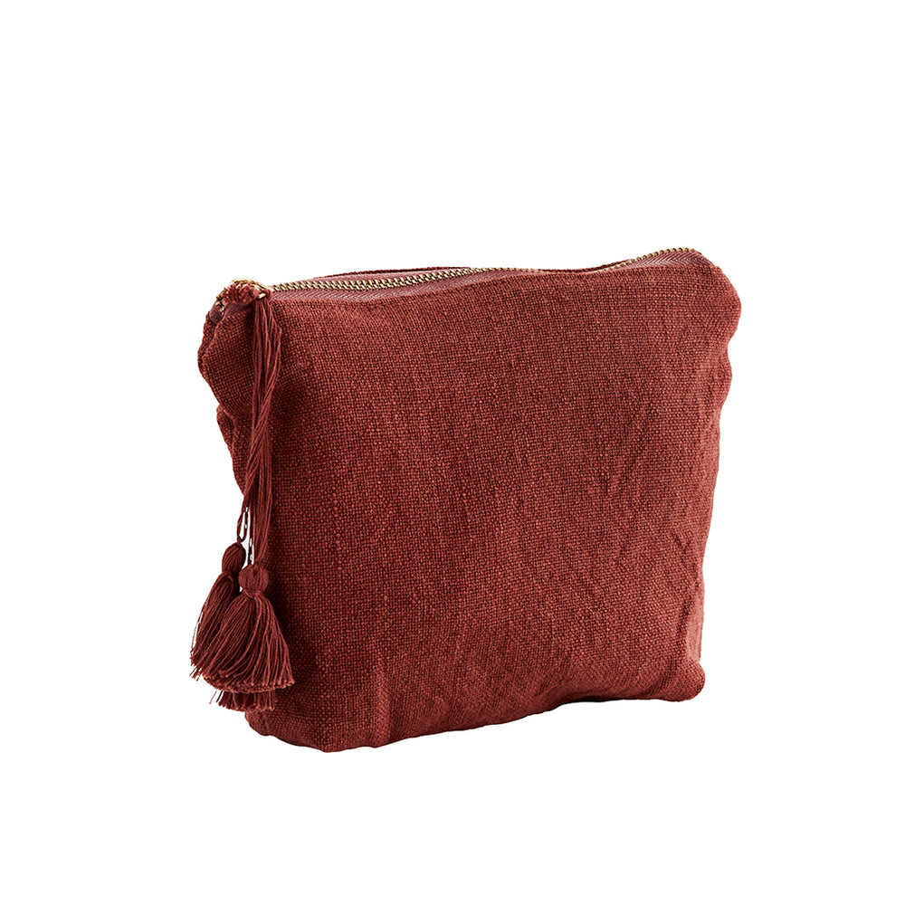 Pouch bag in red textured cotton with tassel and brass zip. Madam Stoltz.