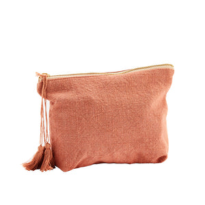 Pouch bag in coral red textured cotton with tassel and brass zip. Madam Stoltz.