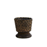 Small brown chalice shaped tealight holder with raised dots around the main cup circled in a slightly lighter brown.