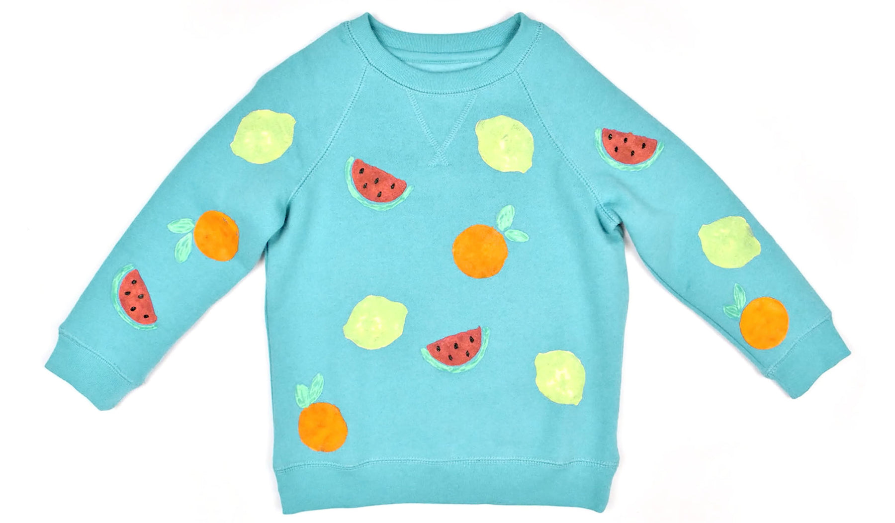 blue sweatshirt with DIY painted fruit shapes