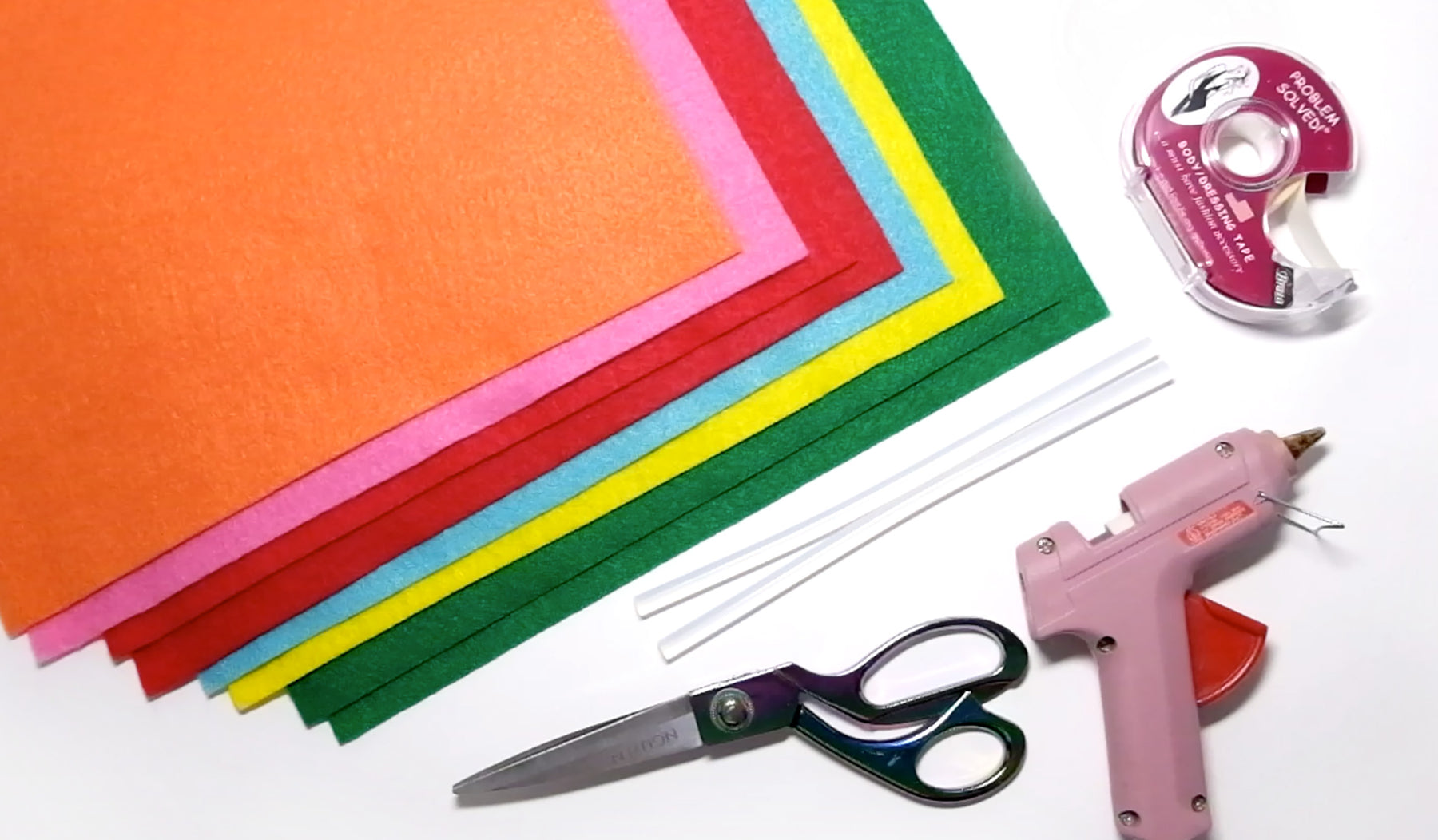 image of rainbow felt, hot glue gun, fabric tape and scissors