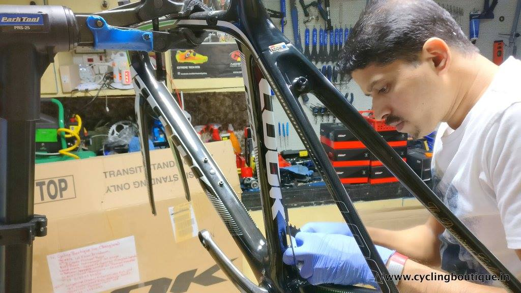 Biju Kunnappada at his state of the art bikeshop workshop in Bengaluru, India with a Look 695 special edition carbon bike, custom build in progress.