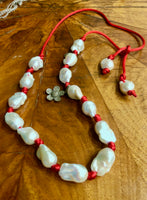 Iridescent Baroque Pearl Necklace on Red Silk with Pave Flower Charm