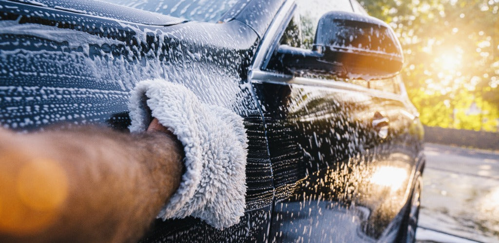 Use Car Shampoo And a Washing Mitt