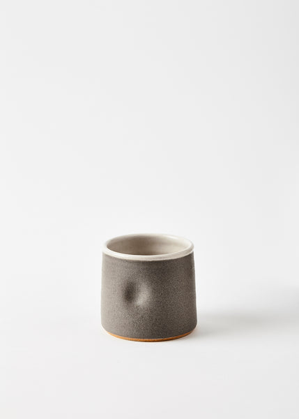 small warm grey beaker