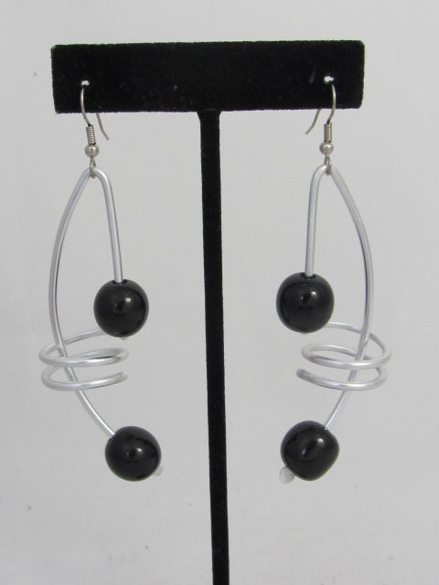 ER 102 - A4  Tagua Note Earrings