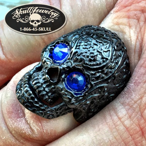 home sick blues black skull ring with blue eyes