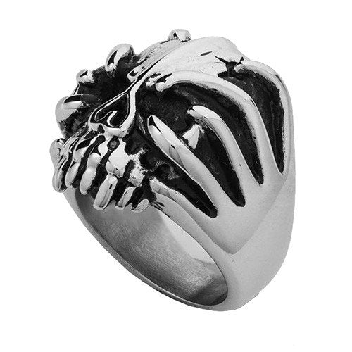 big bold skull ring with fingers wrapped around face