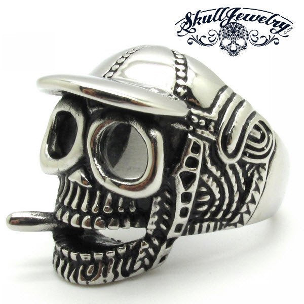 skull ring wearing a cap baseball and vaping