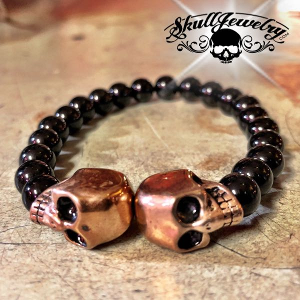 Black Beaded Double Gold Skull Bracelet