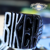 badass biker stainless steel ring sitting on a sturgis vintage harley davidson