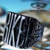 badass biker stainless steel ring sitting on a sturgis harley davidson