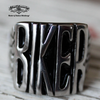 badass biker stainless steel ring sitting on vintage wood