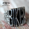 badass biker stainless steel ring on vintage painted wood