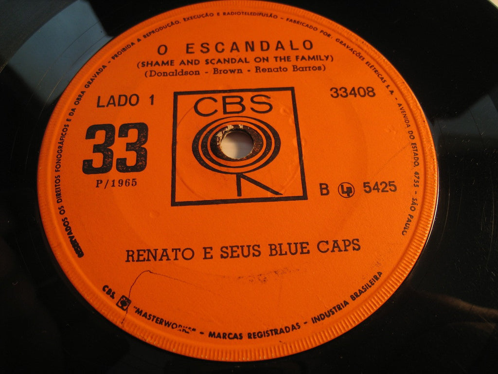 Renato E Seus Blue Caps - O Escandalo (Shame and Scandal on the Family) b/w Preciso Ser Feliz - CBS #5426 - Rock n Roll
