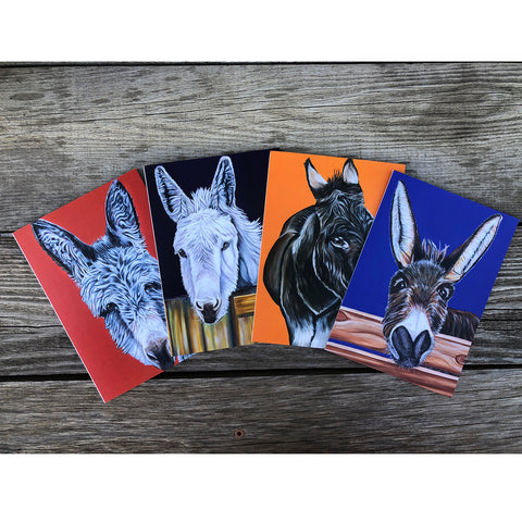 four featured  rescue donkeys in this greeting card pack from the Isle of Wight Donkey Sanctuary